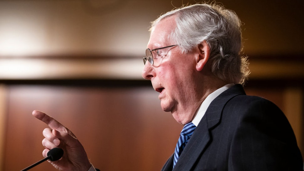 Senate Majority Leader Mitch McConnell (R-KY) holds a news conference after the Senate voted to acquit President Donald Trump on the two articles of impeachment brought by the House of Representatives to the Senate for trial on Capitol Hill on February 5, 2020 in Washington, DC.