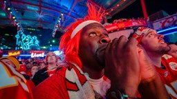 """A Chiefs fans cry""""u2019s while watching the Chiefs take the lead at the Power and Light District as the Kansas City Chiefs take on the San Francisco 49ers in the Super Bowl on February 2, 2020 in Kansas City, Kansas."""