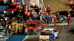 Track workers attend to Ryan Newman, driver of the #6 Koch Industries Ford, following a crash during the NASCAR Cup Series 62nd Annual Daytona 500 at Daytona International Speedway on February 17, 2020 in Daytona Beach, Florida.