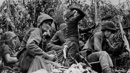 3rd October 1944: Using rifle grenades, hand grenades and 'Molotov cocktails', members of the US Marine Corps attack a Japanese jungle position in Peleliu on the central Pacific Palau Islands.