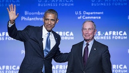 U.S. President Barack Obama, left, waves to the audience after being introduced by Michael Bloomberg, former mayor of New York, at the US-Africa Business Forum in Washington, D.C., U.S., on Tuesday, Aug. 5, 2014.