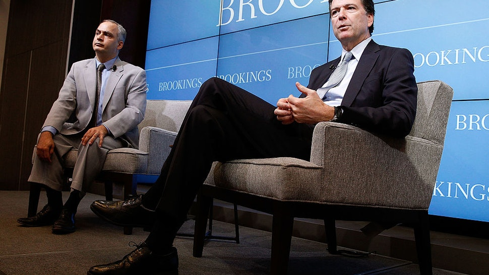 """FBI Director James Comey (R) discusses the impact of technology on the work of law enforcement in a conversation with Benjamin Wittes, Brookings Senior Fellow in Governance Studies, at the """"Going Dark: Are Technology, Privacy, and Public Safety on a Collision Course?"""" event at the Brookings Institution on October 16, 2014 in Washington, DC."""