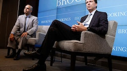 "FBI Director James Comey (R) discusses the impact of technology on the work of law enforcement in a conversation with Benjamin Wittes, Brookings Senior Fellow in Governance Studies, at the ""Going Dark: Are Technology, Privacy, and Public Safety on a Collision Course?"" event at the Brookings Institution on October 16, 2014 in Washington, DC."