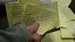 Paper ballots for Donald Trump, president and chief executive of Trump Organization Inc. and 2016 Republican presidential candidate, are organized during the first-in-the-nation Iowa caucus in the Brody Middle School cafeteria in Des Moines, Iowa, U.S., on Monday, Feb. 1, 2016. Iowans headed to statewide Republican and Democratic caucuses on Monday night with the assignment of rendering an initial verdict of the 2016 presidential campaign. Photographer: Andrew Harrer/Bloomberg via Getty Images