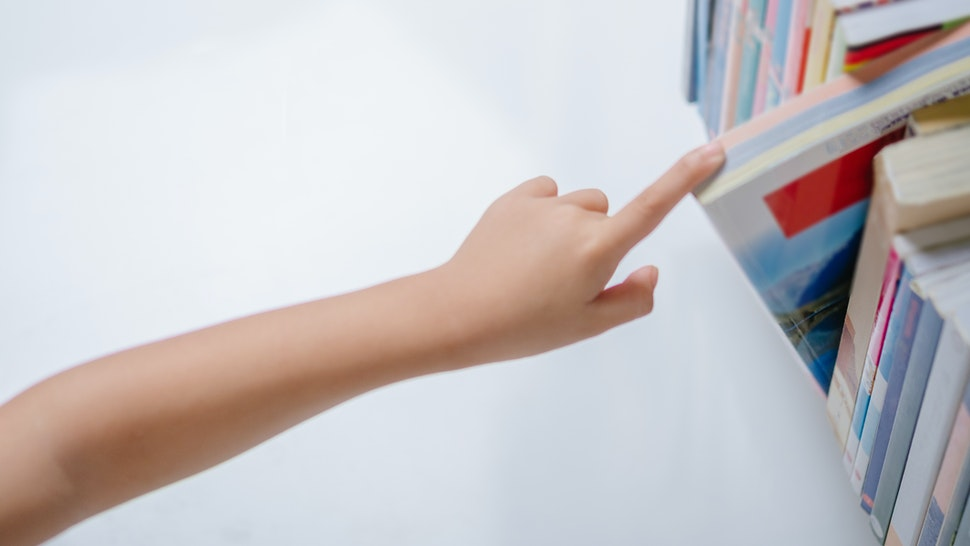 Child reaching for book