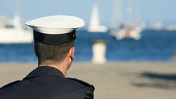 Young sailor in the harbor - stock photo