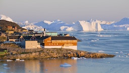 Colourful houses in Illulisat on Greenland Ilulissat is a UNESCO World Heritage Site because of the Jacobshavn Glacier or Sermeq Kujalleq which is the largest glacier outside Antarctica The glacier drains 7% of the Greenland ice sheet and produces enough water from calving icebergs in one day to provide New York with water for 1 year Climate change has meant the glacier has speeded up and is now one of the fastest glaciers in the world at up to 40 metres per day and is also receeding rapidly.