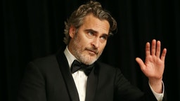 """Joaquin Phoenix poses for photos after winning the Best Actor award for """"Joker"""" at the 92nd Academy Awards ceremony at the Dolby Theatre in Los Angeles, the United States, Feb. 9, 2020. (Photo by Li Ying/Xinhua via Getty)"""