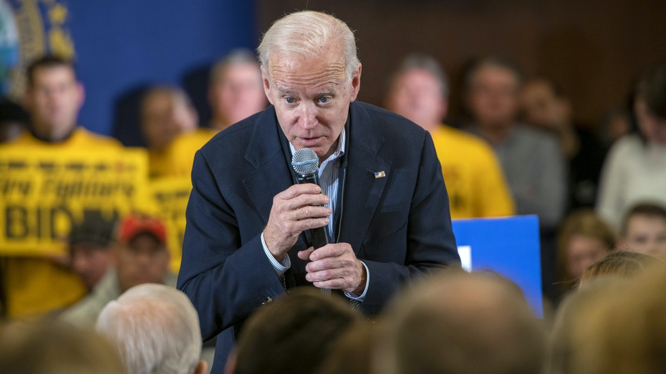Former Vice President Joe Biden, 2020 Democratic presidential candidate, takes a question from an attendee during a GOTV Event in Hampton, New Hampshire, U.S., on Sunday, Feb. 9, 2020. Biden, flagging in the polls, returned to more comfortable territory on the trail by offering subtle contrasts with his Democratic opponents and vowing to stay in the race even if he doesn't have a good showing in the New Hampshire primary.