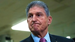 Senator Joe Manchin, a Democrat from West Virginia, pauses while speaking during a news conference in the Senate Subway of the U.S. Capitol in Washington, D.C., U.S., on Wednesday, Feb. 5, 2020. President Donald Trump's inevitable acquittal in the Senate's impeachment trial today has some House Democrats fretting that they should have delivered a more complete case to argue for his removal.