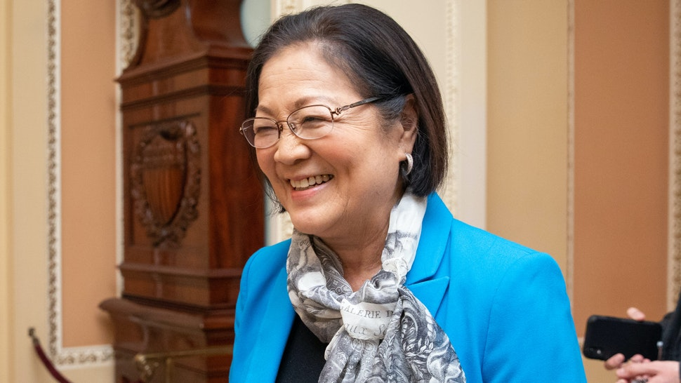 Senator Mazie Hirono, a Democrat from Hawaii, walks with a Senate staff member during a Senate recess at the U.S. Capitol in Washington, D.C., U.S., on Wednesday, Jan. 22, 2020. The Senate set the terms for President Donald Trump's impeachment trial, but not before Majority Leader Mitch McConnell and the president got a reminder that a small group of GOP senators can determine how it will play out.
