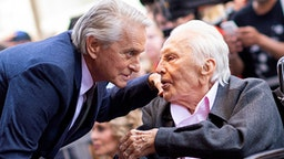 Actor Kirk Douglas (R) attends a ceremony honoring his son actor Michael Douglas (L) with a Star on Hollywood Walk of Fame, in Hollywood, California on November 6, 2018.