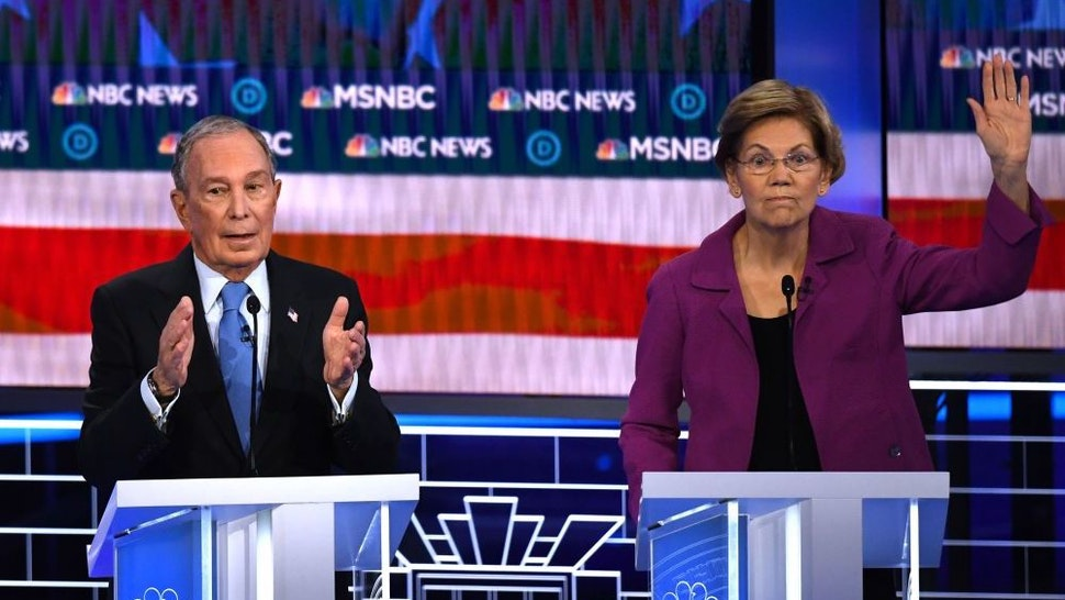 Democratic presidential hopeful Massachusetts Senator Elizabeth Warren (R) gestures next to former New York Mayor Mike Bloomberg during the ninth Democratic primary debate of the 2020 presidential campaign season co-hosted by NBC News, MSNBC, Noticias Telemundo and The Nevada Independent at the Paris Theater in Las Vegas, Nevada, on February 19, 2020. (Photo by Mark RALSTON / AFP)