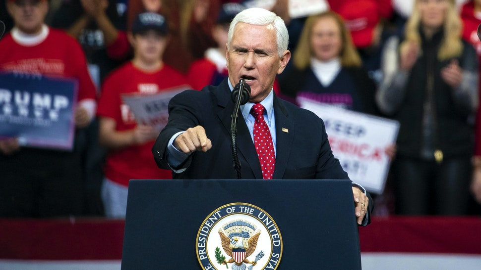 U.S. Vice President Mike Pence speaks during a rally for U.S. President Donald Trump in Des Moines, Iowa, U.S., on Thursday, Jan. 30, 2020. Trump and Democratic presidential hopeful Michael Bloomberg on Thursday unveiled dueling multimillion-dollar campaign ads that are scheduled to air during the Super Bowl on Sunday.