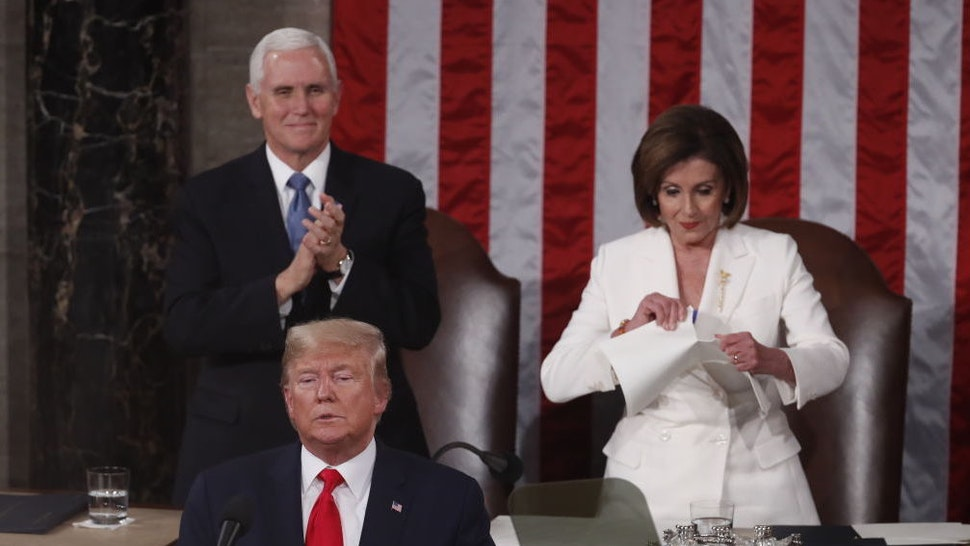 Speaker of the House Nancy Pelosi, a Democrat from California, right, rips up papers after U.S. President Donald Trump, bottom left, delivers a State of the Union address to a joint session of Congress at the U.S. Capitol in Washington, D.C., U.S., on Tuesday, Feb. 4, 2020. President Donald Trump will try to move past his impeachment and make a case for his re-election in Tuesday's State of the Union address by taking credit for a strong economy, newly signed trade deals and an immigration crackdown. Photographer: Andrew Harrer/Bloomberg
