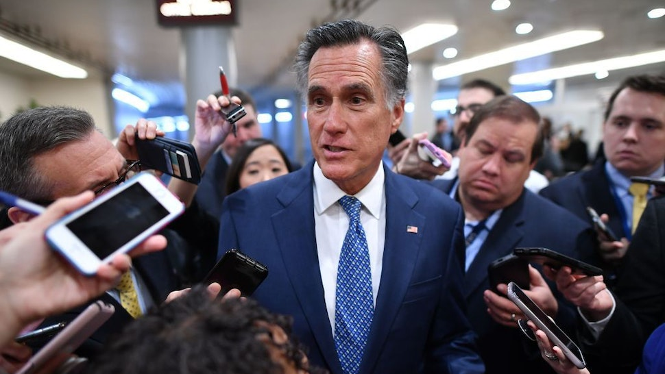 Senator Mitt Romney(R-UT)speaks to the media as he arrives during the impeachment trial of US President Donald Trump on Capitol Hill January 29, 2020, in Washington, DC. - The fight over calling witnesses to testify in President Donald Trump's impeachment trial intensified January 28, 2020 after Trump's lawyers closed their defense calling the abuse of power charges against him politically motivated. Democrats sought to have the Senate subpoena former White House national security advisor John Bolton to provide evidence after leaks from his forthcoming book suggested he could supply damning evidence against Trump. . (Photo by Mandel NGAN / AFP)