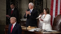 Speaker of the House Nancy Pelosi, a Democrat from California, right, rips up papers after U.S. President Donald Trump, bottom left, delivers a State of the Union address to a joint session of Congress at the U.S. Capitol in Washington, D.C., U.S., on Tuesday, Feb. 4, 2020. PresidentDonald Trumpwill try to move past his impeachment and make a case for his re-election in Tuesday'sStateoftheUnionaddress by taking credit for a strong economy, newly signed trade deals and an immigration crackdown. Photographer: Al Drago/Bloomberg