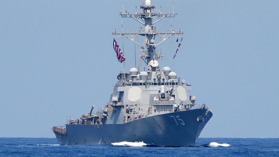 """A photo taken on August 7, 2019, shows the US Navy USS Donald Cook class guided missile destroyer during an exercise how simulate a humanitarian response to a powerful earthquake and significant movement of IDF vessels and foreign vessels in the Mediterranean sea. - Sailors from France, Greece and the United States arrived on their vessels and were joined by the Israelis off the Israeli port city of Haifa for a four-day exercise, called """"Mighty Waves"""". It simulated extracting wounded civilians to sea for treatment, fishing people out of the water and transferring humanitarian aid, with representatives of seven other navies taking part as observers."""