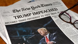 The December 19, 2019 edition of The New York Times carries a headline 'Trump Impeached'. (Photo by Robert Alexander/Getty Images)