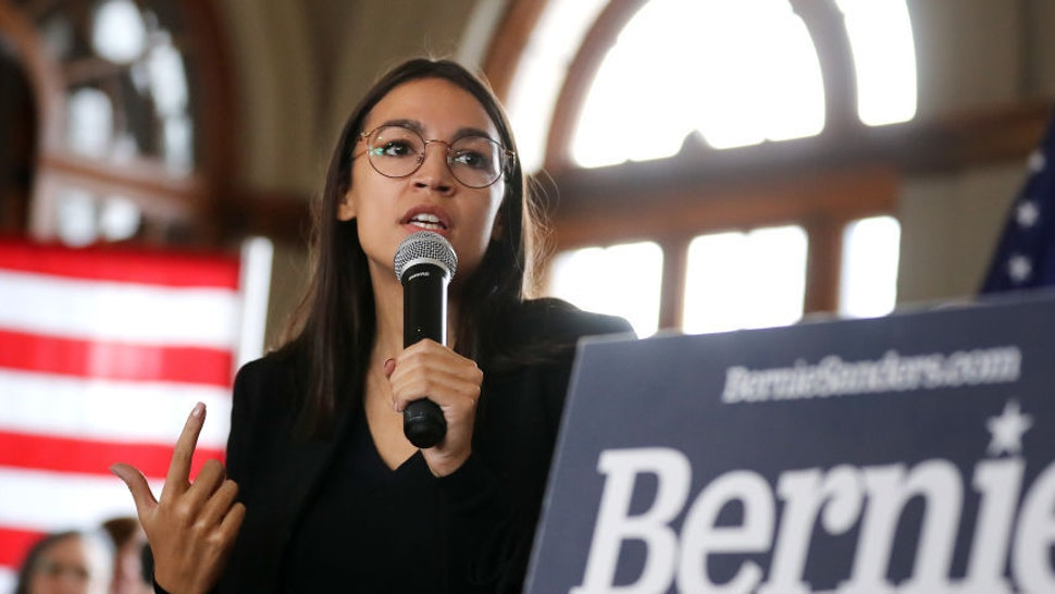 Rep. Alexandria Ocasio-Cortez (D-NY) speaks during a campaign event with Democratic presidential candidate Sen. Bernie Sanders (I-VT) at La Poste January 26, 2020 in Perry, Iowa. A New York Times/Siena College poll conducted January 20-23 places Sanders at the top of a long list of Democrats seeking the presidential nomination with 25-percent of likely Iowa caucus-goers naming him as their first choice. Candidates former South Bend, Indiana Mayor Pete Buttigieg, former Vice President Joe Biden and Sen. Elizabeth Warren (D-MA) are polling at 18, 17 and 15-percent, respectively. (Photo by Chip Somodevilla/Getty Images)