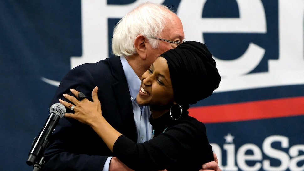 MANCHESTER, UNITED STATES - 2019/12/13: Vermont Senator and presidential candidate Bernie Sanders and Minnesota Congresswoman Ilhan Omar embrace each other during the campaigns at Southern New Hampshire University in Manchester.