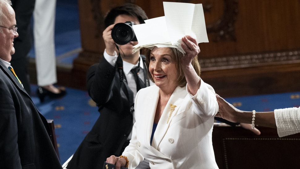 UNITED STATES - FEBRUARY 4: Speaker of the House Nancy Pelosi, D-Calif., holds up the copy of President Donald Trumps speech that she ripped up at the conclusion of his State of the Union address to a joint session of Congress in the Capitol on Tuesday, Feb. 4, 2020.