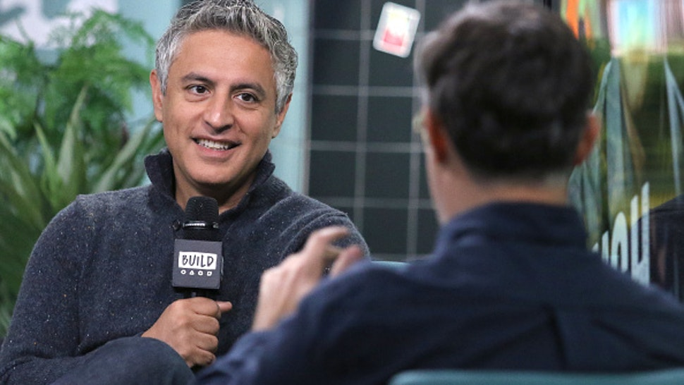 """NEW YORK, NEW YORK - NOVEMBER 14: Writer Reza Aslan (L) and moderator Ricky Camilleri attends the Build Series to discuss his TV program """"Rough Draft"""" at Build Studio on November 14, 2019 in New York City."""
