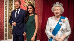 """The figures of the Duke and Duchess of Sussex in their original positions next to Queen Elizabeth II, as Madame Tussauds London moved its figures of the couple from its Royal Family set to elsewhere in the attraction, in the wake of the announcement that they will take a step back as """"senior members"""" of the royal family, dividing their time between the UK and North America."""