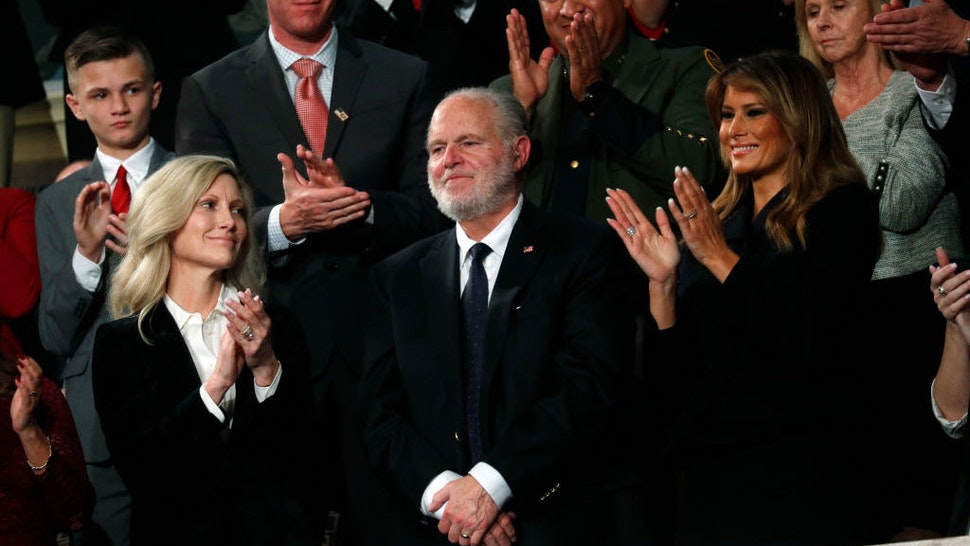 Radio personality Rush Limbaugh is honored by U.S. President Donald Trump with a Presidential Medal of Freedom as he stands with first lady Melania Trump during the State of the Union address to a joint session of the U.S. Congress in the House Chamber of the U.S. Capitol in Washington, U.S. February 4, 2020. REUTERS/Leah Millis/POOL