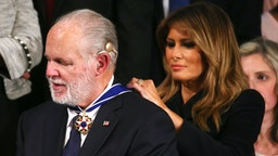 WASHINGTON, DC - FEBRUARY 04: Radio personality Rush Limbaugh reacts as First Lady Melania Trump gives him the Presidential Medal of Freedom during the State of the Union address in the chamber of the U.S. House of Representatives on February 04, 2020 in Washington, DC. President Trump delivers his third State of the Union to the nation the night before the U.S. Senate is set to vote in his impeachment trial.