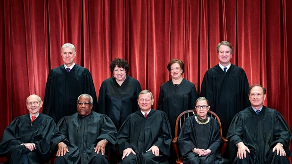 Justices of the US Supreme Court pose for their official photo at the Supreme Court in Washington, DC on November 30, 2018. - Standing from left: Associate Justice Neil Gorsuch, Associate Justice Sonia Sotomayor, Associate Justice Elena Kagan and Associate Justice Brett Kavanaugh.Seated from left to right, bottom row: Associate Justice Stephen Breyer, Associate Justice Clarence Thomas, Chief Justice John Roberts, Associate Justice Ruth Bader Ginsburg and Associate Justice Samuel Alito.