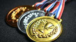 Close-Up Of Medals On Black Table - stock photo