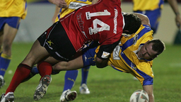 Rowan Baxter of the Lions tackled by Clinton Fraser (L) during the NZRL National Premiership Bartercard Cup Grand Final league match between the Auckland Lions and Canterbury Bulls played at Mount Smart Stadium on September 18, 2006 in Auckland New Zealand.