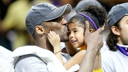 Kobe Bryant #24 of the Los Angeles Lakers kisses his daughter, Gianna, after the Lakers defeated the Orlando Magic 99-86 in Game Five of the 2009 NBA Finals on June 14, 2009 at Amway Arena in Orlando, Florida.