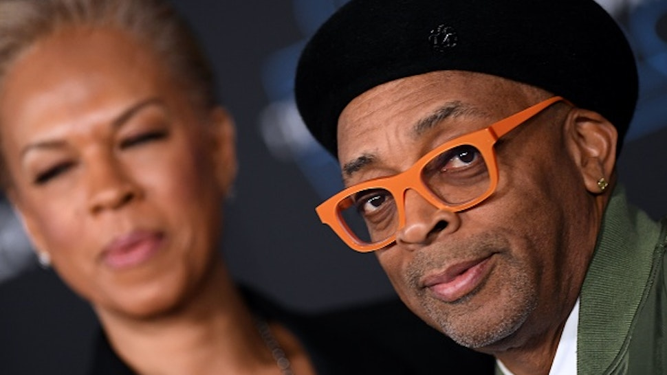 """US film director Spike Lee (R) and wife Tonya Lewis Lee arrive for the world premiere of Disney's """"Star Wars: Rise of Skywalker"""" at the TCL Chinese Theatre in Hollywood, California on December 16, 2019."""