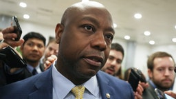 Sen. Tim Scott (R-SC) speaks to reporters as he arrives at the U.S. Capitol as the Senate impeachment trial of U.S. President Donald Trump continues on January 31, 2020 in Washington, DC. Senators are expected to vote on whether to allow witnesses to testify in the trial today.