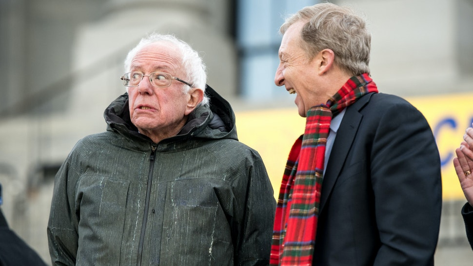 COLUMBIA, SC - JANUARY 20: Democratic presidential candidates, Sen. Bernie Sanders (I-VT), left, reacts to a conversation with Tom Steyer during the King Day at the Dome rally on January 20, 2020 in Columbia, South Carolina. The event, first held in 2000 in opposition to the display of the Confederate battle flag at the statehouse, attracted more than a handful Democratic presidential candidates looking for votes in the early primary state.