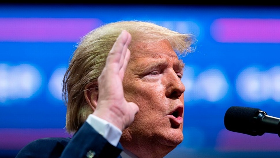"""US President Donald Trump gestures as he addresses a """"Keep America Great"""" rally in Colorado Springs, Colorado, on February 20, 2020."""