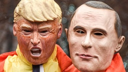 A protester dressed as the United States President Donald Trump holds a mask of Russian President Vladimir Putin during the march. Women's March is an annual event that is held across the United States every year to honour women's rights. There were marches in many cities across our country this afternoon, and they were attended by women's rights activists, politicians, and citizens, alike. (Photo by Whitney Saleski/SOPA Images/LightRocket via Getty Images)