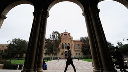 LOS ANGELES, CA - APRIL 23: A student walks near Royce Hall on the campus of UCLA on April 23, 2012 in Los Angeles, California. According to reports, half of recent college graduates with bachelor's degrees are finding themselves underemployed or jobless.