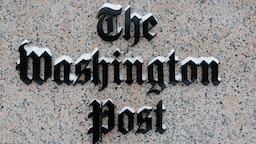WASHINGTON, DC - JANUARY 23: Washington Post logo outside of the building covered with snow.