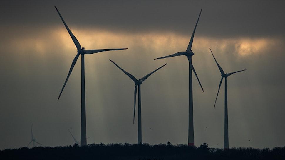 23 January 2020, North Rhine-Westphalia, Altenbeken: Wind turbines can be seen against a cloudy sky.