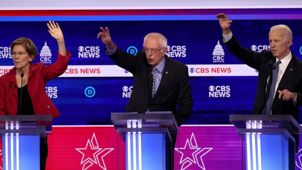 CHARLESTON, SOUTH CAROLINA - FEBRUARY 25: Democratic presidential candidates (L-R) Sen. Elizabeth Warren (D-MA), Sen. Bernie Sanders (I-VT) and former Vice President Joe Biden participate the Democratic presidential primary debate at the Charleston Gaillard Center on February 25, 2020 in Charleston, South Carolina. Seven candidates qualified for the debate, hosted by CBS News and Congressional Black Caucus Institute, ahead of South Carolina's primary in four days. (Photo by