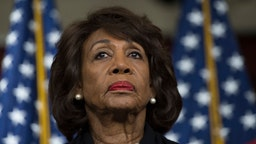 US Representative Maxine Waters (D-CA) looks on before speaking to reports regarding the Russia investigation on Capitol Hill in Washington, DC on January 9, 2018