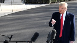 U.S. President Donald Trump speaks to members of the media before boarding Marine One on the South Lawn of the White House in Washington, D.C., U.S., on Sunday, Feb. 23, 2020. Trumpoffered tepid support forMick Mulvaney, days after the acting White House chief of staff made candid comments in the U.K. that broke with elements of the administration's policies. Photographer: