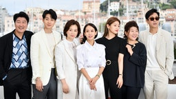 "South Korean actor Kang-ho Song, South Korean actor Choi Woo-shik, South korean actress Chang Hyae-jin, South Korean actress Cho Yeo-jeong, South Korean actress Park So-dam, South Korean actress Lee Jung-Eun and South Korean actor Lee Sun-kyun pose during a photocall for the film ""Parasite (Gisaengchung)"" at the 72nd edition of the Cannes Film Festival in Cannes, southern France, on May 22, 2019."