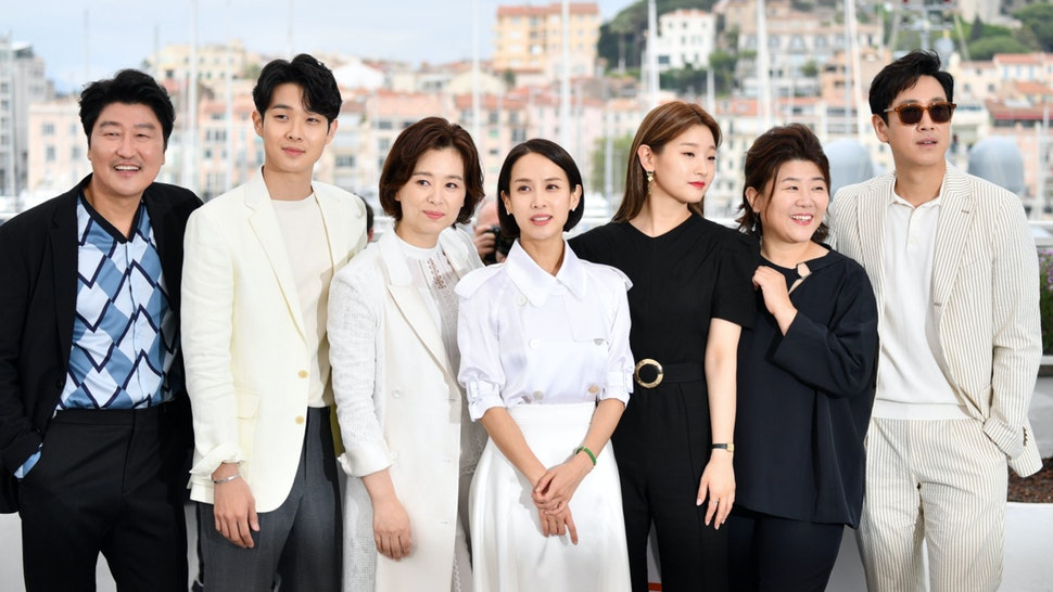 """South Korean actor Kang-ho Song, South Korean actor Choi Woo-shik, South korean actress Chang Hyae-jin, South Korean actress Cho Yeo-jeong, South Korean actress Park So-dam, South Korean actress Lee Jung-Eun and South Korean actor Lee Sun-kyun pose during a photocall for the film """"Parasite (Gisaengchung)"""" at the 72nd edition of the Cannes Film Festival in Cannes, southern France, on May 22, 2019."""
