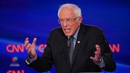 Democratic presidential hopeful Vermont Senator Bernie Sanders gestures as he takes part in the 11th Democratic Party 2020 presidential debate in a CNN Washington Bureau studio in Washington, DC on March 15, 2020.