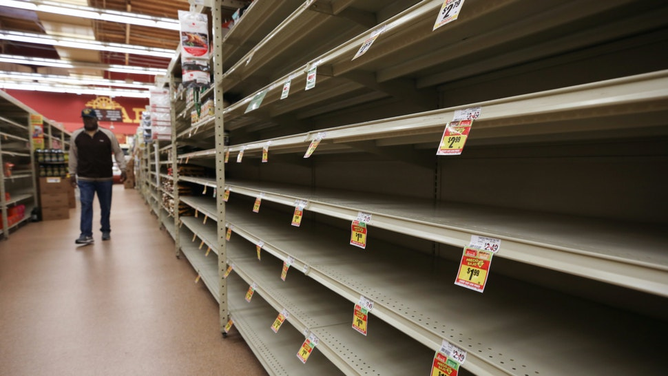 A section of empty shelves is seen during special shopping hours only open to seniors and the disabled at Northgate Gonzalez Market, a Hispanic specialty supermarket, on March 19, 2020 in Los Angeles, California.