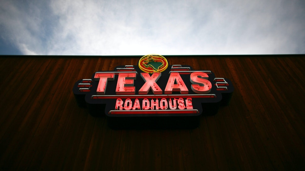 Texas Roadhouse Inc. signage is displayed outside of a restaurant in Arvada, Colorado, U.S., on Friday, March 11, 2011.